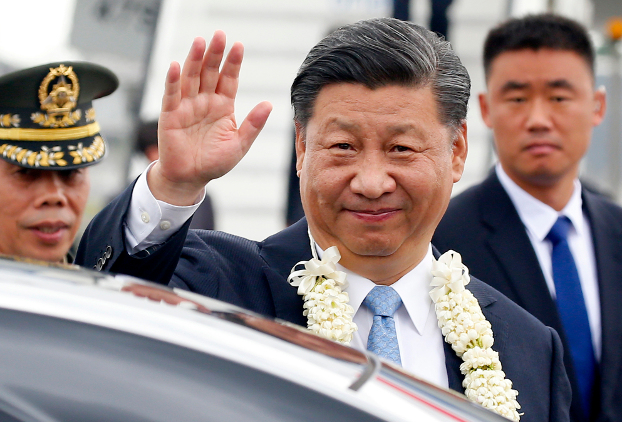 Chinese President Xi Jinping waves after arriving at Ninoy Aquino International Airport near Manila, Nov. 20, 2018.