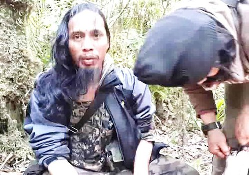 A screenshot from a 2016 video shows Santoso (left), the then-leader of MIT, with one of his men, hiding out in the forests of Central Sulawesi province in Indonesia, February 2016. [BenarNews]