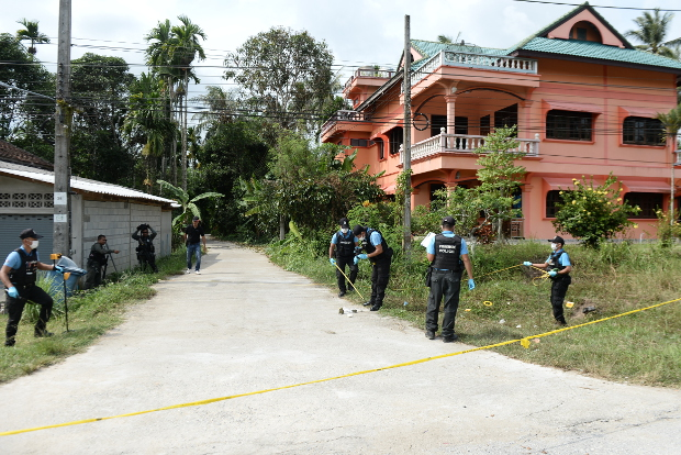 Thai police inspect the site of a drive-by shooting that killed a woman and her daughter in Bacho, a district of Narathiwat province in Thailand's insurgency-stricken Deep South, Aug. 11, 2018.