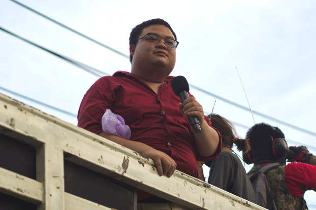 """Parit """"Penguin"""" Chiwarak speaks from the back of a truck during a rally outside the 11th Infantry Regiment in Bangkok, Nov. 29, 2020."""