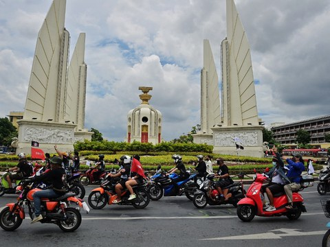 Thai protesters ride in a convoy past the Democracy Monument during an anti-government demonstration in Bangkok, Sept. 10, 2021.