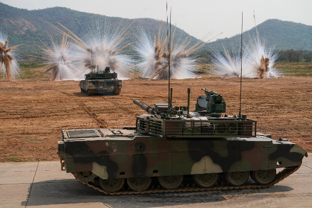 Thailand's Chinese-made VT-4 tanks fire smoke grenades to counter against laser target locks from other weapons during a demonstration in Saraburi province, Jan. 26, 2018. (Pimuk Rakkanam/BenarNews)
