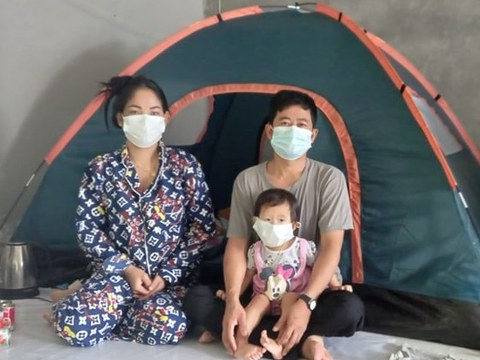 Mean La, a Cambodian opposition activist living in Thailand, is photographed with her husband and their 1-year-old daughter.