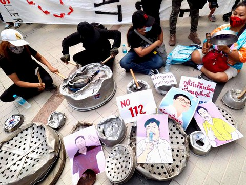 Thai pro-democracy demonstrators bang pots and pans to demand the release of four activist leaders jailed for allegedly insulting the monarchy, during a protest in Bangkok, Feb. 10, 2021.