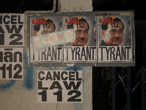 Posters depicting Thai Prime Minister Prayuth Chan-o-cha are seen during an anti-government protest in Bangkok demanding the release of arrested leaders charged with royal defamation, March 6, 2021.