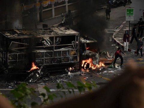 A police detention truck burns after being set on fire during an anti-government protest in Bangkok, August 7, 2021.