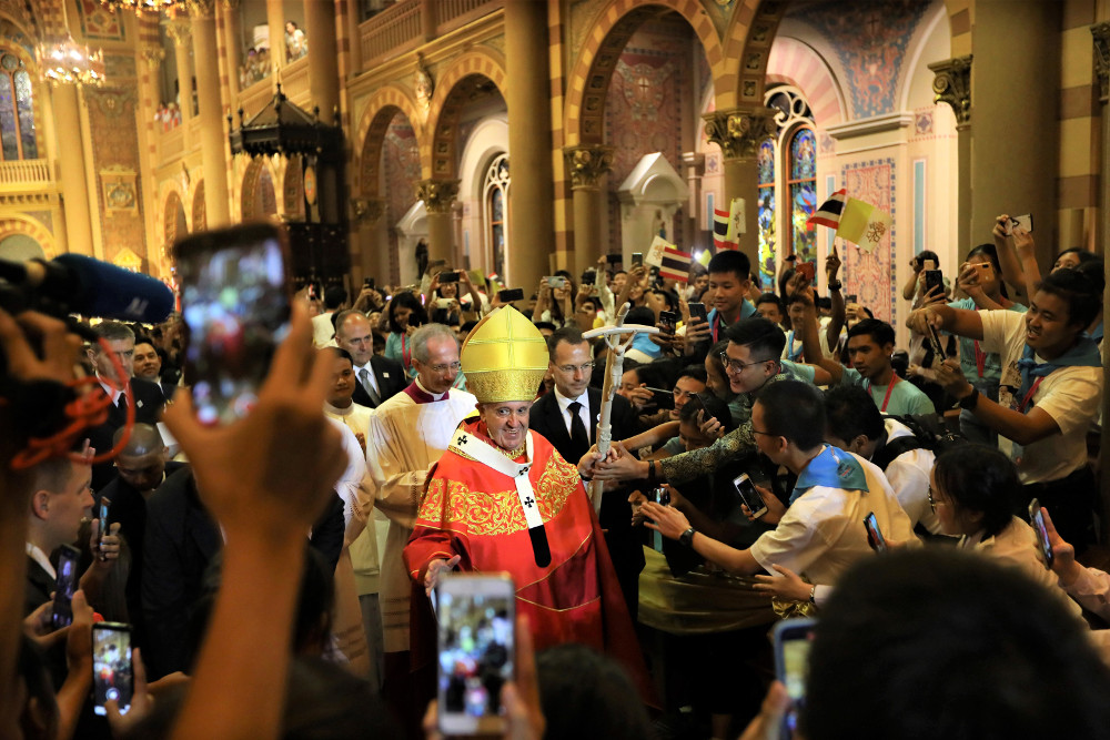 Pope Francis leaves after celebrating Mass at the Assumption Cathedral, in Bangkok, Nov. 22, 2019. [AP]