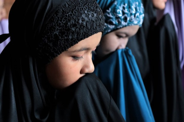 Girls in Yala province, Thailand, pray for COVID-19 to pass and for their loved ones to be safe as they celebrate Eid al-Fitr, May 13, 2021.