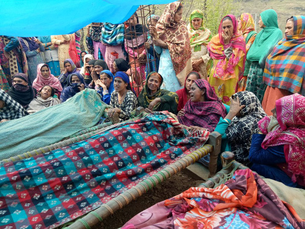Women wail after a mortar shell allegedly fired by Pakistani soldiers killed three children near the Line of Control, the demarcation line that divides the disputed Kashmir territory, March 18, 2018. [Sheikh Mashooq/BenarNews]