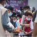 Satgas Protokol Kesehatan PON Papua membagikan masker kepada warga yang mengantre untuk masuk menyaksikan pertandingan cabang olahraga futsal PON XX di Gor SP 2, Kabupaten Mimika, 1 Oktober 2021.