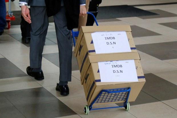 1MDB: Putrajaya Saman Firma Audit AS$5.6 Bilion