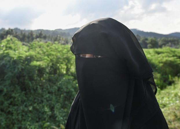Aisyah bergambar di luar rumah ibunya di Terengganu, Malaysia, 22 Mei 2019. [S. Mahfuz/BeritaBenar]